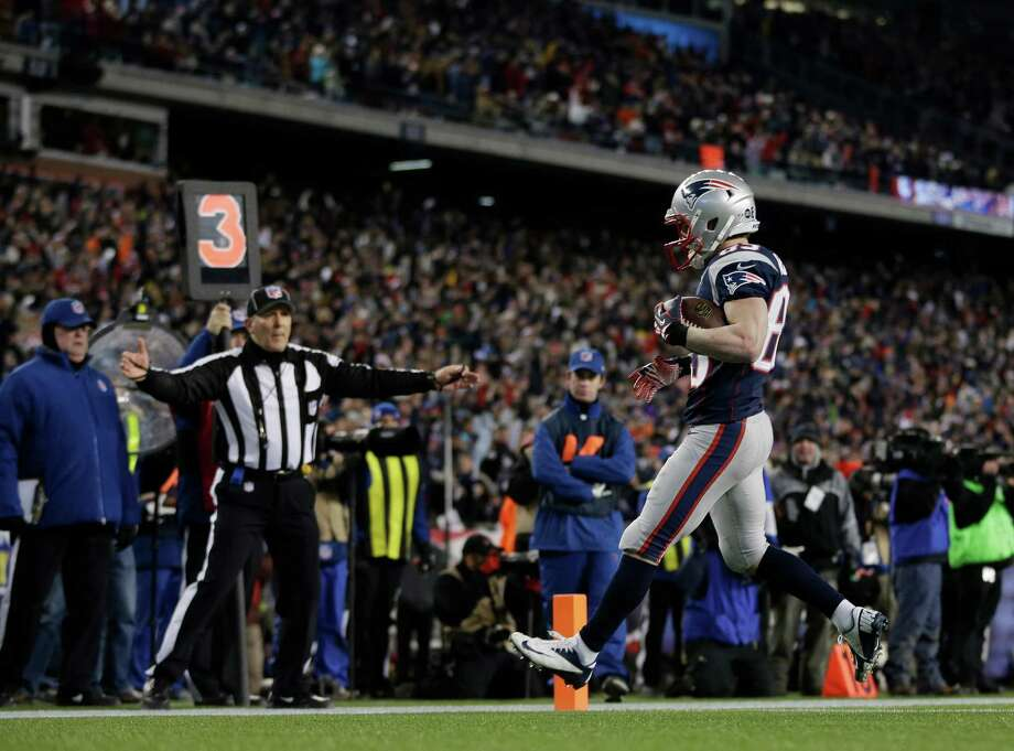 New England Patriots wide receiver Wes Welker (83) celebrates his 1-yard touchdown catch during the first half of the NFL football AFC Championship football game against the Baltimore Ravens in Foxborough, Mass., Sunday, Jan. 20, 2013. (AP Photo/Matt Slocum) Photo: Matt Slocum, Associated Press / AP