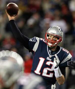 New England Patriots quarterback Tom Brady  throws a pass during the first half of the NFL football AFC Championship football game against the Baltimore Ravens in Foxborough, Mass., Sunday, Jan. 20, 2013. (AP Photo/Stephan Savoia) Photo: Stephan Savoia, Associated Press / AP