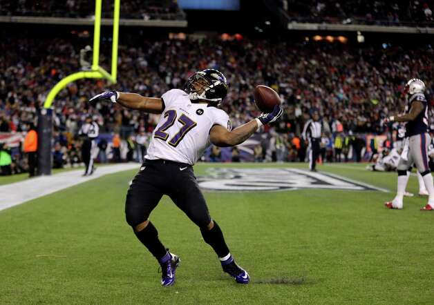 Baltimore Ravens running back Ray Rice (27) celebrates his 2-yard touchdown run against the New England Patriots during the first half of the NFL football AFC Championship football game in Foxborough, Mass., Sunday, Jan. 20, 2013. (AP Photo/Charles Krupa) Photo: Charles Krupa, Associated Press / AP