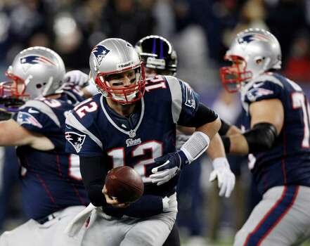 New England Patriots quarterback Tom Brady (12) looks to make a handoff during the first half of the NFL football AFC Championship football game against the Baltimore Ravens in Foxborough, Mass., Sunday, Jan. 20, 2013. (AP Photo/Stephan Savoia) Photo: Stephan Savoia, Associated Press / AP