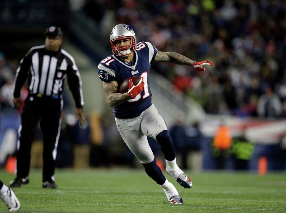 New England Patriots tight end Aaron Hernandez runs after a catch against the Baltimore Ravens during the first half of the NFL football AFC Championship football game in Foxborough, Mass., Sunday, Jan. 20, 2013.(AP Photo/Matt Slocum) Photo: Matt Slocum, Associated Press / AP
