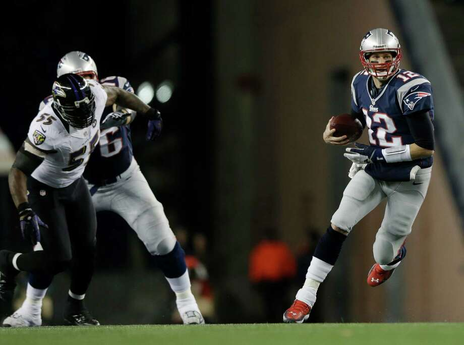New England Patriots quarterback Tom Brady, right, runs with the ball while being chased by Baltimore Ravens linebacker Terrell Suggs (55) during the first half of the NFL football AFC Championship football game against the Baltimore Ravens in Foxborough, Mass., Sunday, Jan. 20, 2013. (AP Photo/Matt Slocum) Photo: Matt Slocum, Associated Press / AP