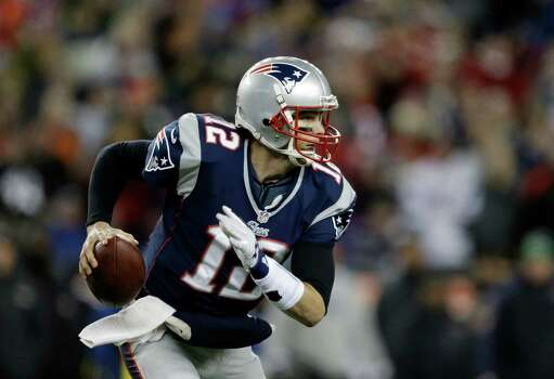 New England Patriots quarterback Tom Brady (12) runs against the Baltimore Ravens during the first half of the NFL football AFC Championship football game in Foxborough, Mass., Sunday, Jan. 20, 2013. (AP Photo/Steven Senne) Photo: Steven Senne, Associated Press / AP