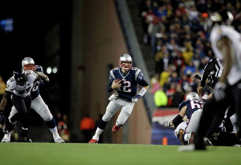 New England Patriots quarterback Tom Brady (12) runs against the Baltimore Ravens during the first half of the NFL football AFC Championship football game in Foxborough, Mass., Sunday, Jan. 20, 2013. (AP Photo/Matt Slocum) Photo: Matt Slocum, Associated Press / AP