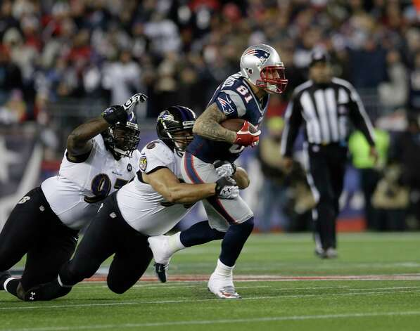 New England Patriots tight end Aaron Hernandez (81) is tackled by Baltimore Ravens nose tackle Ma'ake Kemoeatu (96) following a reception during the first half of the NFL football AFC Championship football game in Foxborough, Mass., Sunday, Jan. 20, 2013. (AP Photo/Elise Amendola) Photo: Elise Amendola, Associated Press / AP
