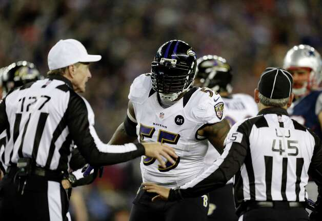 Referee Bill Leavy, left, talks to Baltimore Ravens outside linebacker Terrell Suggs (55) during the first half of the NFL football AFC Championship football game against the New England Patriots in Foxborough, Mass., Sunday, Jan. 20, 2013. (AP Photo/Steven Senne) Photo: Steven Senne, Associated Press / AP