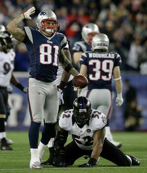 New England Patriots tight end Aaron Hernandez (81) reacts after making a catch for a first down against Baltimore Ravens inside linebacker Ray Lewis (52) during the first half of the NFL football AFC Championship football game in Foxborough, Mass., Sunday, Jan. 20, 2013. (AP Photo/Elise Amendola) Photo: Elise Amendola, Associated Press / AP