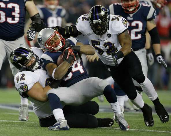 New England Patriots running back Shane Vereen (34) is tackled by Baltimore Ravens defensive end Haloti Ngata (92) and Ray Lewis (52) during the first half of the NFL football AFC Championship football game in Foxborough, Mass., Sunday, Jan. 20, 2013. (AP Photo/Steven Senne) Photo: Steven Senne, Associated Press / AP