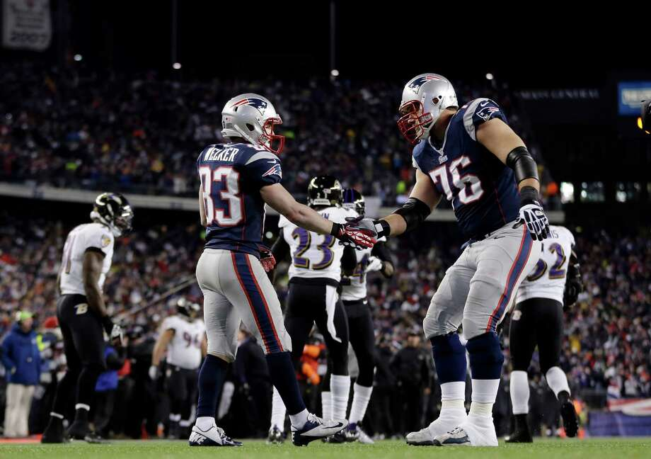New England Patriots wide receiver Wes Welker (83) celebrates his 1-yard touchdown catch with tackle Sebastian Vollmer (76) during the first half of the NFL football AFC Championship football game against the Baltimore Ravens in Foxborough, Mass., Sunday, Jan. 20, 2013. (AP Photo/Matt Slocum) Photo: Matt Slocum, Associated Press / AP