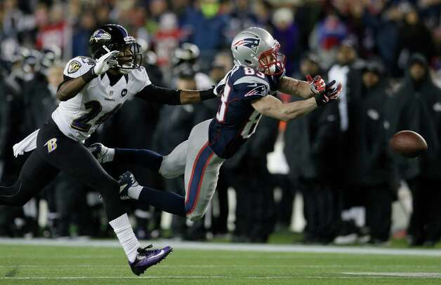 New England Patriots wide receiver Wes Welker (83) dives while being defended by Baltimore Ravens cornerback Corey Graham (24) during the first half of the NFL football AFC Championship football game in Foxborough, Mass., Sunday, Jan. 20, 2013. The pass was incomplete. (AP Photo/Elise Amendola) Photo: Elise Amendola, Associated Press / AP