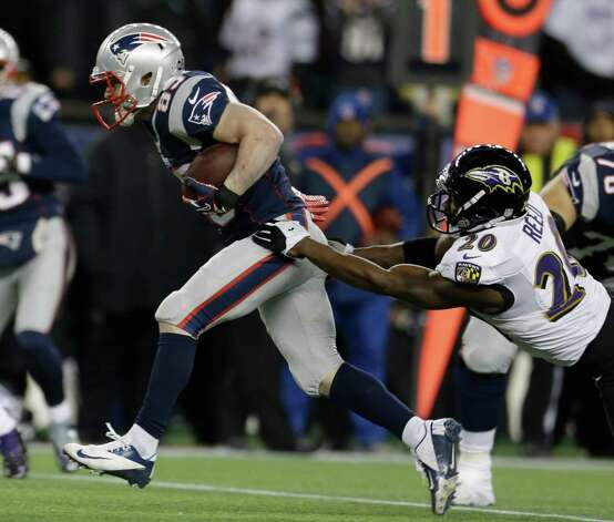 New England Patriots wide receiver Wes Welker (83) runs out of the tackle of Baltimore Ravens free safety Ed Reed (20) during the first half of the NFL football AFC Championship football game in Foxborough, Mass., Sunday, Jan. 20, 2013. (AP Photo/Elise Amendola) Photo: Elise Amendola, Associated Press / AP