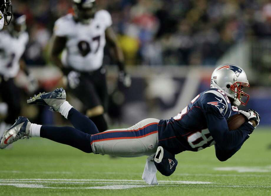 New England Patriots wide receiver Brandon Lloyd makes a catch during the first half of the NFL football AFC Championship football game against the Baltimore Ravens in Foxborough, Mass., Sunday, Jan. 20, 2013. (AP Photo/Matt Slocum) Photo: Matt Slocum, Associated Press / AP