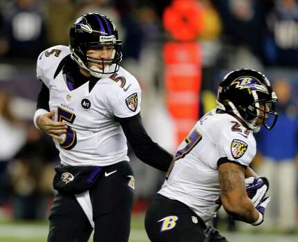 Baltimore Ravens quarterback Joe Flacco (5) hands off to running back Ray Rice (27) during the first half of the NFL football AFC Championship football game against the New England Patriots in Foxborough, Mass., Sunday, Jan. 20, 2013. (AP Photo/Charles Krupa) Photo: Charles Krupa, Associated Press / AP