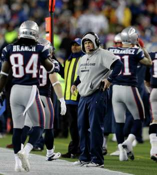 New England Patriots head coach Bill Belichick, right, watches from the sidelines during the first half of the NFL football AFC Championship football game against the Baltimore Ravens in Foxborough, Mass., Sunday, Jan. 20, 2013. (AP Photo/Steven Senne) Photo: Steven Senne, Associated Press / AP