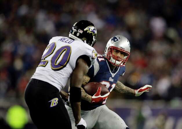 Baltimore Ravens free safety Ed Reed (20)pursues New England Patriots tight end Aaron Hernandez (81) after a catch during the first half of the NFL football AFC Championship football game in Foxborough, Mass., Sunday, Jan. 20, 2013. (AP Photo/Matt Slocum) Photo: Matt Slocum, Associated Press / AP
