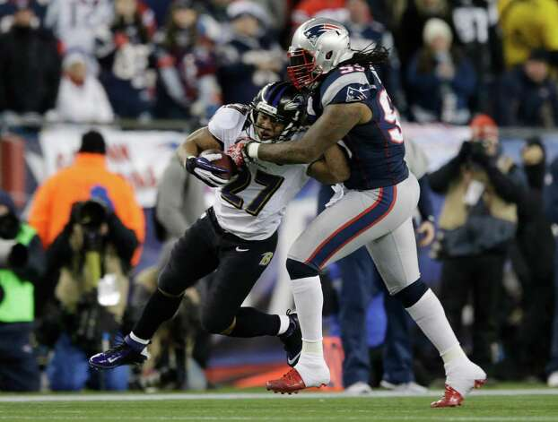Baltimore Ravens running back Ray Rice (27) is tackled by New England Patriots linebacker Mike Rivera during the first half of the NFL football AFC Championship football game in Foxborough, Mass., Sunday, Jan. 20, 2013. (AP Photo/Matt Slocum) Photo: Matt Slocum, Associated Press / AP