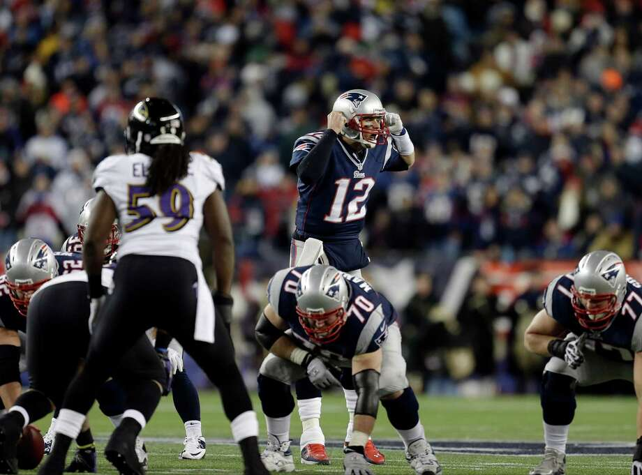 New England Patriots quarterback Tom Brady (12) calls signals at the line in front of Baltimore Ravens inside linebacker Dannell Ellerbe (59) during the first half of the NFL football AFC Championship football game in Foxborough, Mass., Sunday, Jan. 20, 2013. (AP Photo/Steven Senne) Photo: Steven Senne, Associated Press / AP