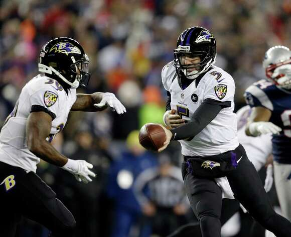 Baltimore Ravens quarterback Joe Flacco (5) hands off to running back Bernard Pierce (30) during the first half of the NFL football AFC Championship football game against the New England Patriots in Foxborough, Mass., Sunday, Jan. 20, 2013. (AP Photo/Steven Senne) Photo: Steven Senne, Associated Press / AP