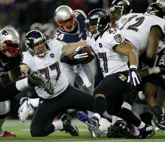 Baltimore Ravens running back Ray Rice (27) runs with the ball during the first half of the NFL football AFC Championship football game against the New England Patriots in Foxborough, Mass., Sunday, Jan. 20, 2013. (AP Photo/Elise Amendola) Photo: Elise Amendola, Associated Press / AP