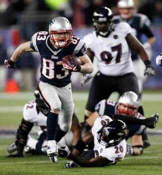 New England Patriots wide receiver Wes Welker (83) runs out of the tackle of Baltimore Ravens free safety Ed Reed (20) during the first half of the NFL football AFC Championship football game in Foxborough, Mass., Sunday, Jan. 20, 2013. (AP Photo/Stephan Savoia) Photo: Stephan Savoia, Associated Press / AP