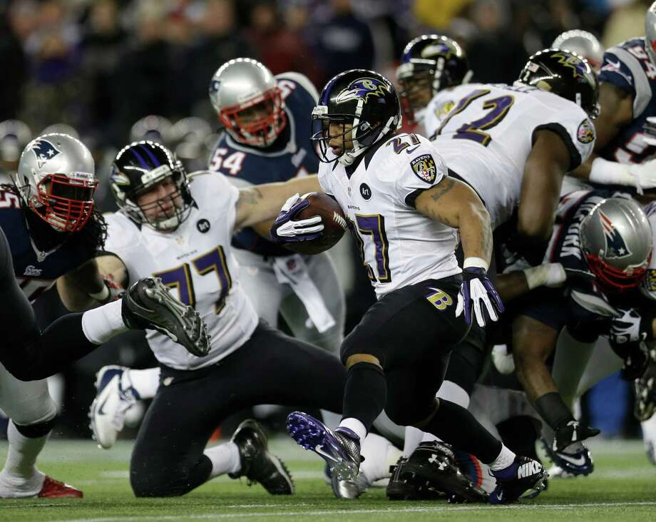 Baltimore Ravens running back Ray Rice (27) runs the ball during the first half of the NFL football AFC Championship football game against the New England Patriots in Foxborough, Mass., Sunday, Jan. 20, 2013. (AP Photo/Elise Amendola) Photo: Elise Amendola, Associated Press / AP