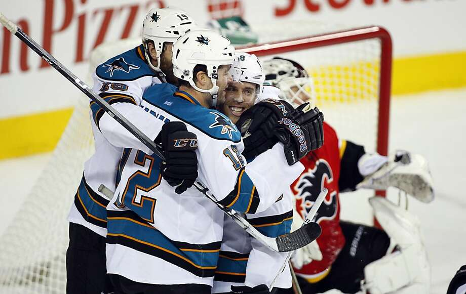 Patrick Marleau (center) celebrates with Joe Thornton (left) and Joe Pavelski after one of his two goals in a three-goal second period for the Sharks. Photo: Jeff McIntosh, Associated Press
