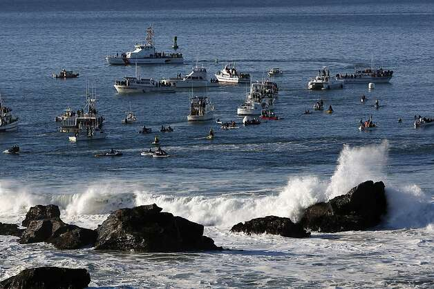 Boats full of spectators and media representatives circle the competition and help those aboard enjoy the picture-perfect weather off Half Moon Bay. Photo: Sean Havey, The Chronicle