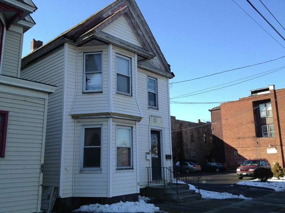 A view of 1108 Albany St., Schenectady on Jan. 20, 2013. The city is trying to sell the two-family house as part of its HOMES program, a new effort to unload foreclosed properties in hopes they will be rehabbed.