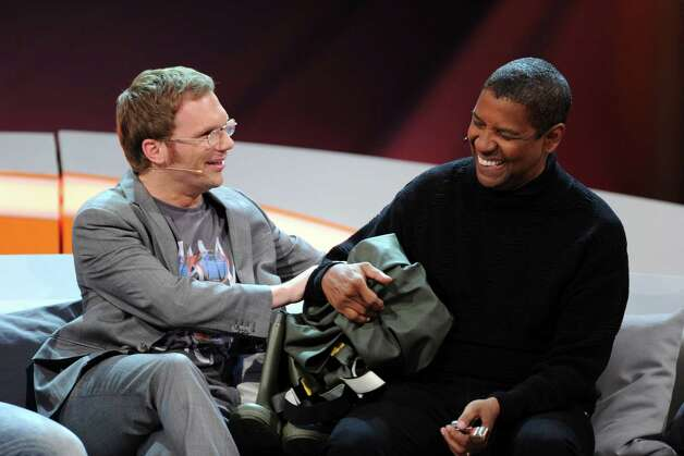 In this picture made available Sunday, Jan. 20, 2013, German comedian Ralf Schmitz, left, and US actor Denzel Washington joke during the German TV show 'Wetten Dass...?' (Bet It...?) in Offenburg, southern Germany, Saturday, Jan. 19, 2013. (AP Photo/dpa, Uli Deck) Photo: Uli Deck
