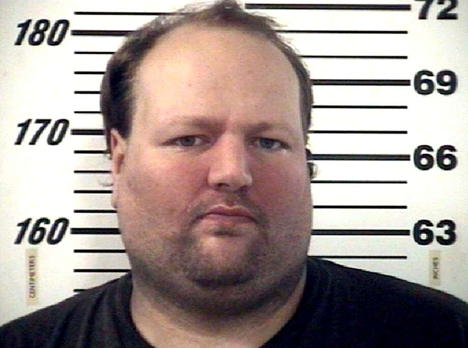 This December 2012 handout photo provided by the Effingham County Sheriff's Office shows Chad Moretz. A SWAT team sniper shot 34-year-old Moretz on Jan. 11, 2013, ending a four-hour standoff when Moretz emerged from his Effingham County home armed with an assault rifle. (AP Photo/Courtesy of the Effingham County Sheriff's Office) Photo: Uncredited