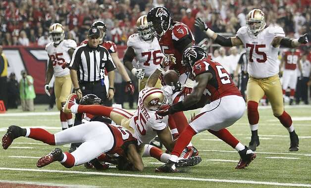 Receiver Michael Crabtree fumbles near the Falcons' goal line while trying to take a Colin Kaepernick pass into the end zone for a go-ahead touchdown in the fourth quarter with the 49ers down 24-21. Photo: Michael Macor, The Chronicle
