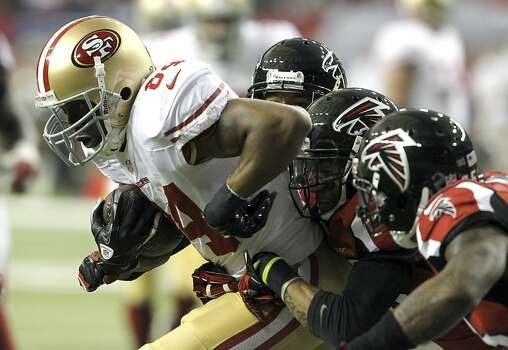 Wide receiver Randy Moss (84) runs through the Falcons defense during the second half of the San Francisco 49ers game against the Atlanta Falcons in the NFC Championship game at the Georgia Dome in Atlanta, GA., on Sunday January 20, 2013. Photo: Brant Ward, The Chronicle