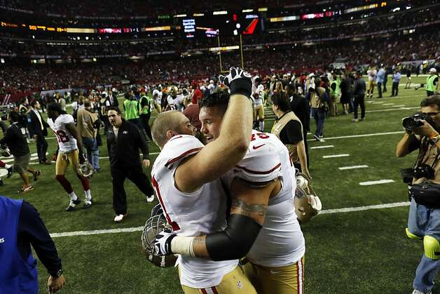 Linemen Daniel Kilgore (left) and Alex Boone celebrate the 49ers' win. Photo: Carlos Avila Gonzalez, The Chronicle