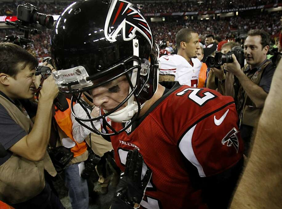 Atlanta quarterback Matt Ryan walked away after greeting Colin Kaepernick at midfield. The San Francisco 49ers beat the Atlanta Falcons 28-24 to win the NFC title and advance to the Super Bowl Sunday January 20, 2013. Photo: Brant Ward, The Chronicle