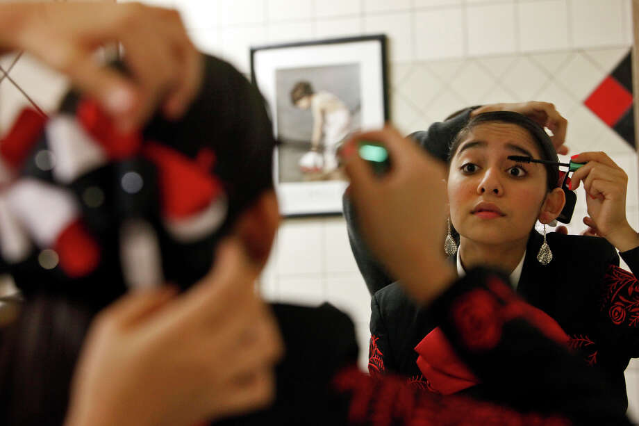 Leslie Diaz, 14, gets ready with members of Mariachi Los Lobos at Palmview High School for the evening's performance for the La Joya Independent School District board during a meeting where they were also recognized with Grupo Folklorico Ozomatli for their accomplishments on Thursday, Jan. 10, 2013. Photo: Lisa Krantz, Express-News / © 2012 San Antonio Express-News