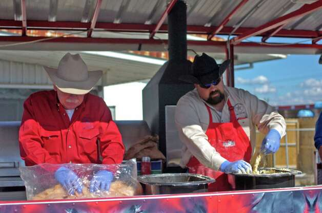 Deral Ellerbee and  A.J. Boudreaux of Jefferson County Go-Texan prepare fish Sunday at a Knights of Columbus council 951 fish fry benefitting Boys' Haven. The event was a joint venture including assistance from Elks Lodge 311. Photo: Sarah Moore