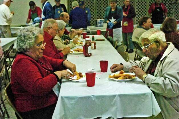 Lupe and Gilbert Saldana of Beaumont enjoy a fish dinner Sunday at the Knights of Columbus Council 951 Hall. The fish fry, benefiting Boys' Haven, was a joint effort that included assistance from Jefferson County Go-Texan and Elks Lodge 311. Photo: Sarah Moore