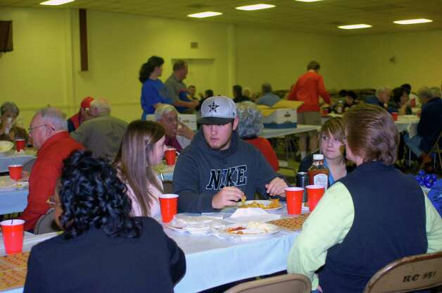 Diners enjoy a fish dinner Sunday at the Knights of Columbus Council 951. The fish fry, benefiting Boys' Haven, was a joint effort between the Knights of Columbus, Jefferson County Go-Texan and Elks Lodge 311. Photo: Sarah Moore