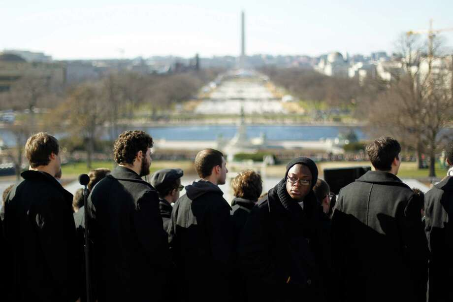 Singers from the Lee University Festival Choir of Cleveland Tennessee, rehearse on Sunday, January 20, 2013, in preparation for Monday's Presidential Inauguration in Washington D.C. Photo: Chris Walker, McClatchy-Tribune News Service / Chicago Tribune