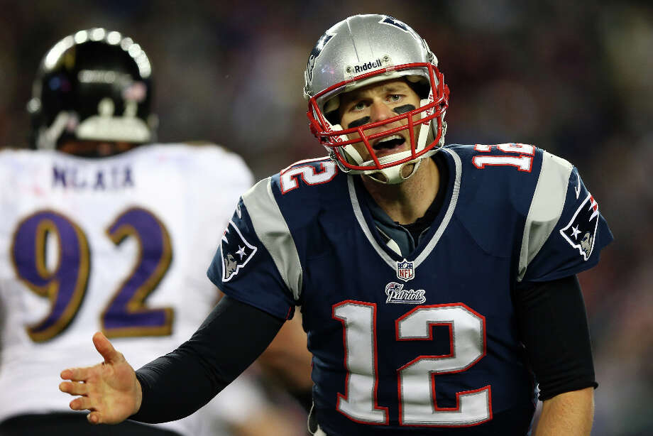 Tom Brady #12 of the Patriots reacts after a play against the Ravens. Photo: Elsa, Getty Images / 2013 Getty Images