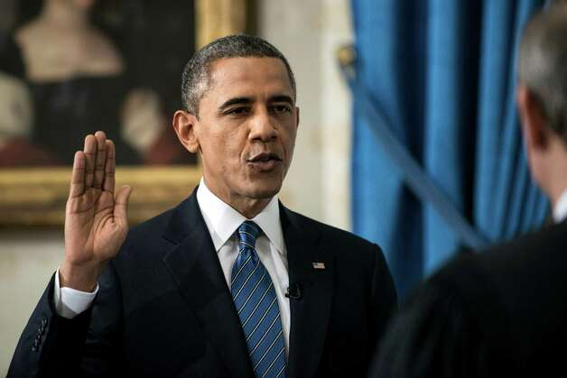 President Barack Obama is officially sworn-in by Chief Justice John Roberts in the Blue Room of the White House during the 57th Presidential Inauguration in Washington, Sunday, Jan. 20, 2013. (AP Photo/Brendan Smialowski, Pool) Photo: Brendan Smialowski