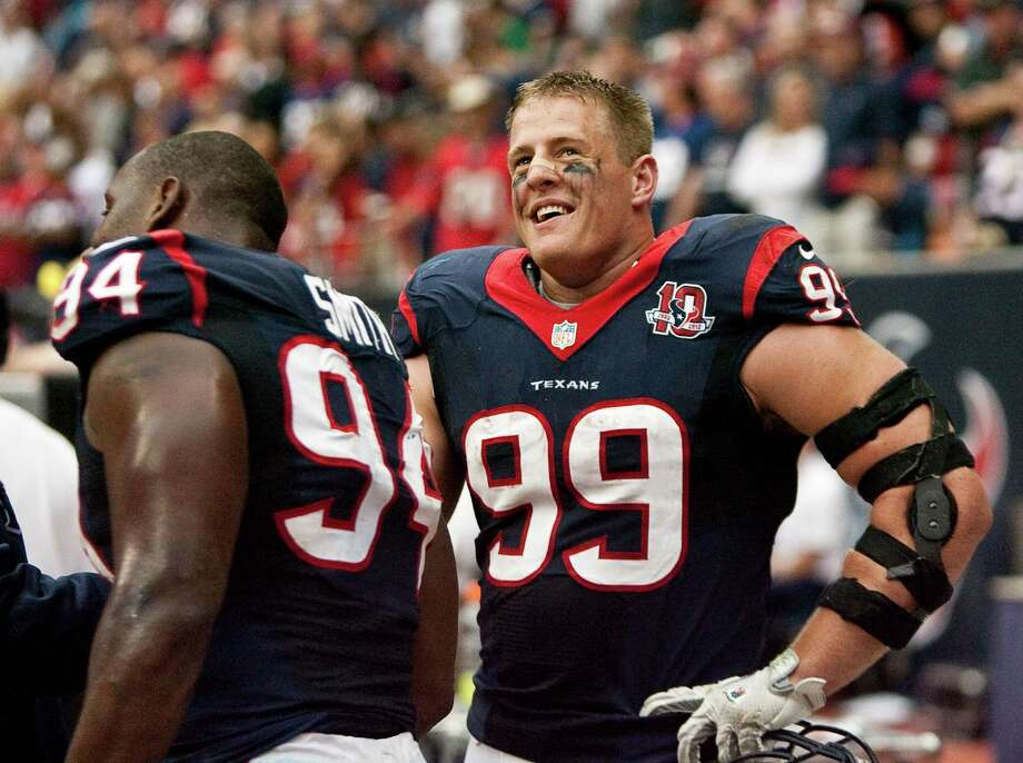 Texans defensive ends J.J. Watt (99) and Antonio Smith combined for 271/2 sacks this season, with Watt's 201/2 leading the NFL. Photo: Nick De La Torre, Staff / © 2012  Houston Chronicle