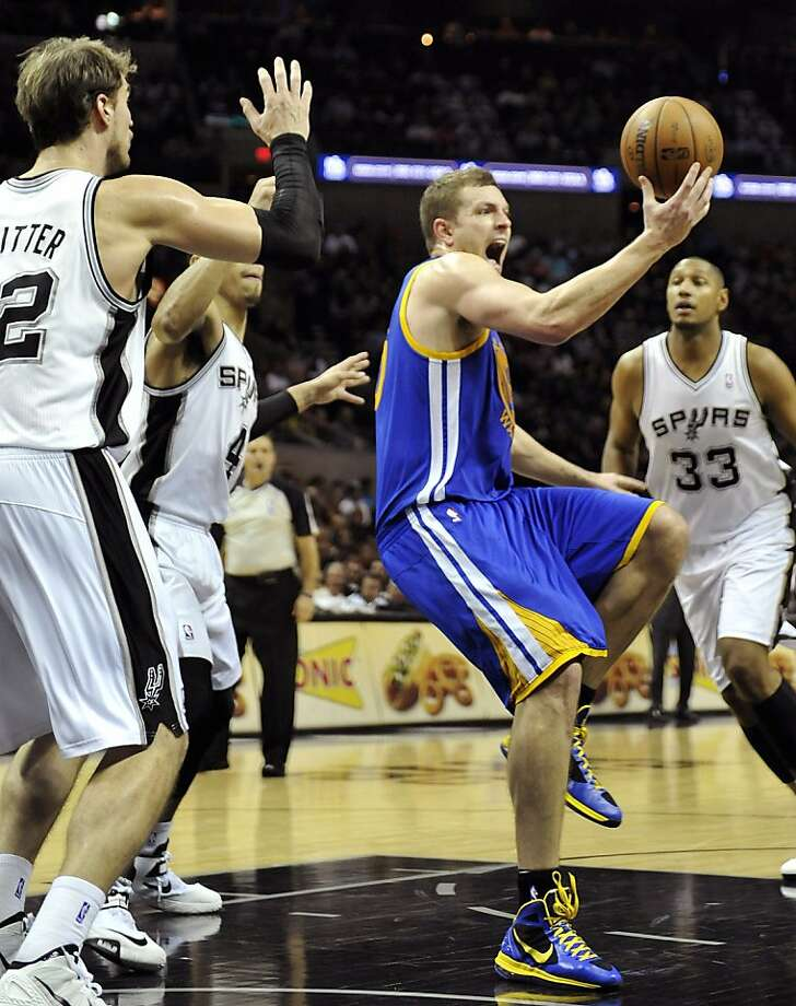 David Lee grimaces after turning his ankle Friday in San Antonio. Lee says he will play Monday. Photo: Mark Sobhani, Associated Press