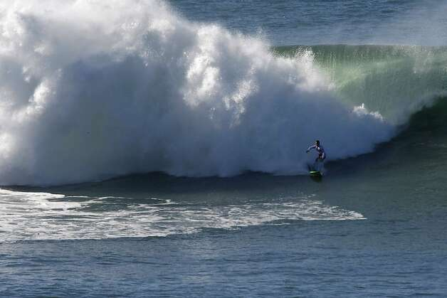 Tashnick tries to escape the white water of a big wave at Mavericks Surf Competition on January 20, 2013 in Half Moon Bay, Calif. Photo: Sean Havey, The Chronicle