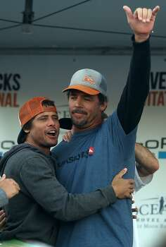 Peter Mel, winner of this year's Mavericks Invitational, is congratulated by Alex Martins on Sunday, January 20, 2013. Photo: Mathew Sumner, Special To The Chronicle
