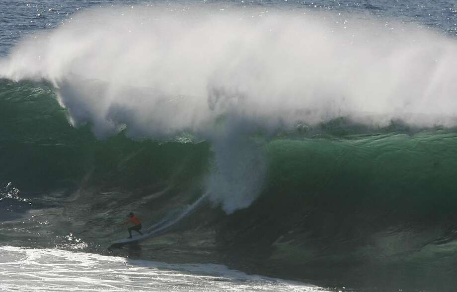 Ryan Wormhoudt gets in a barrel during the final round of Mavericks Surf Competition on January 20, 2013 in Half Moon Bay, Calif. Photo: Sean Havey, The Chronicle