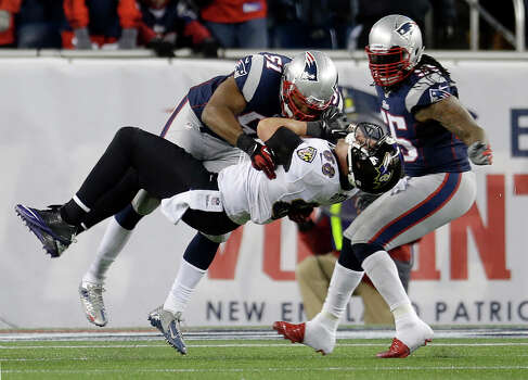 New England Patriots outside linebacker Jerod Mayo (51) tackles Baltimore Ravens tight end Dennis Pitta (88) after a reception during the second half of the NFL football AFC Championship football game in Foxborough, Mass., Sunday, Jan. 20, 2013. (AP Photo/Elise Amendola) Photo: Elise Amendola, Associated Press / AP