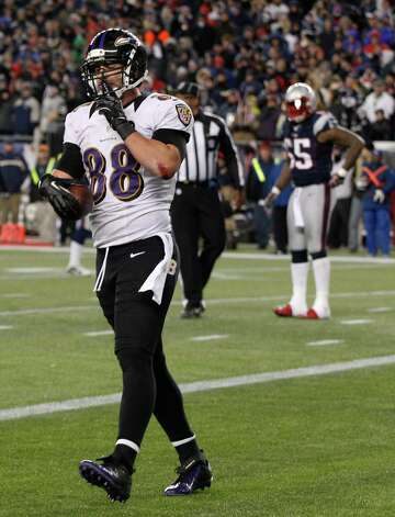 Baltimore Ravens tight end Dennis Pitta (88) reacts following a five-yard touchdown reception during the second half of the NFL football AFC Championship football game against the New England Patriots in Foxborough, Mass., Sunday, Jan. 20, 2013. (AP Photo/Stephan Savoia) Photo: Stephan Savoia, Associated Press / AP