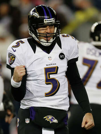 Baltimore Ravens quarterback Joe Flacco reacts after throwing a five-yard touchdown pass to Dennis Pitta during the second half of the NFL football AFC Championship football game against the New England Patriots in Foxborough, Mass., Sunday, Jan. 20, 2013. (AP Photo/Charles Krupa) Photo: Charles Krupa, Associated Press / AP