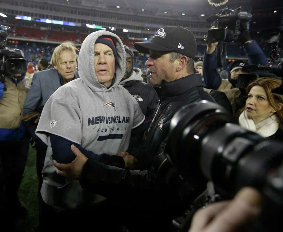 New England Patriots head coach Bill Belichick, left, and Baltimore Ravens head coach John Harbaugh, right, meet at midfield after the NFL football AFC Championship football game in Foxborough, Mass., Sunday, Jan. 20, 2013.  The Ravens won 28-13 to advance to Super Bowl XLVII. (AP Photo/Elise Amendola) Photo: Elise Amendola, Associated Press / AP